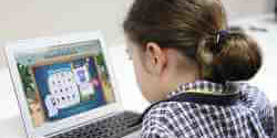 Girl playing LiteracyPlanet on laptop